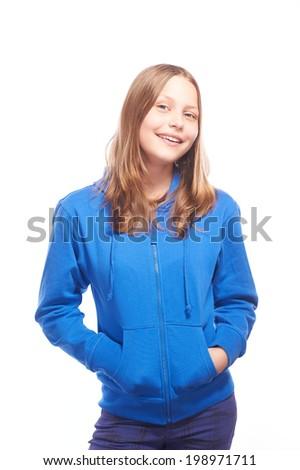 Happy teen girl laughing, studio shot - stock photo