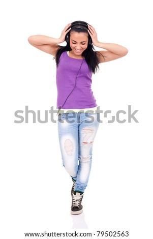 happy teen girl listening to music, full length, isolated on white - stock photo