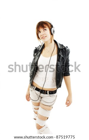 Happy teen girl listening to music isolated on white background - stock photo