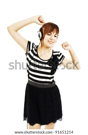 Happy teen girl listening to music. Isolated on white background - stock photo