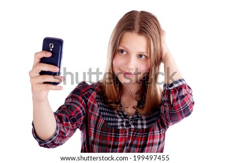 Happy teen girl make pictures of herself, studio shot - stock photo