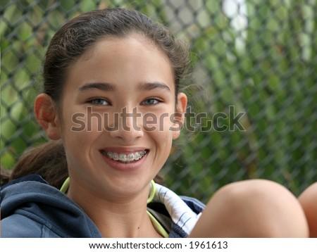 Happy teen girl with braces - stock photo