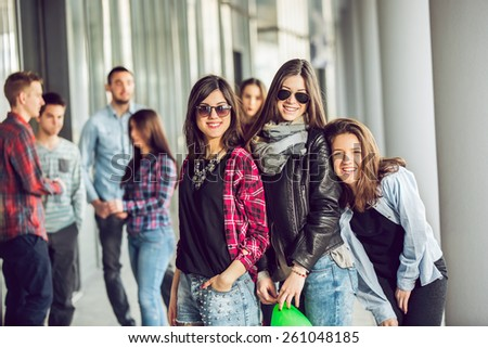 Happy teen girls and boys having good fun time outdoors. Selective focus  - stock photo