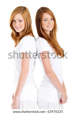 happy teen girls back to back - stock photo