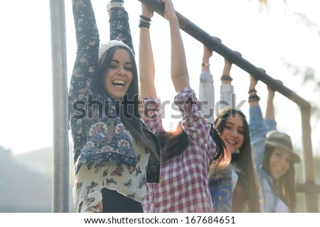 Happy teen girls having good fun time outdoors - stock photo