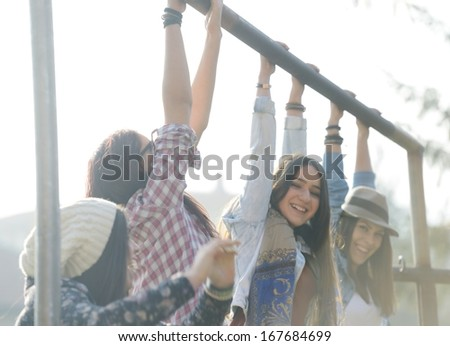 Happy teen girls having good fun time outdoors - stock photo