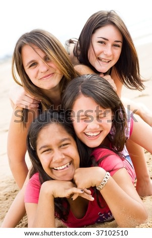 happy teen girls playing together - stock photo