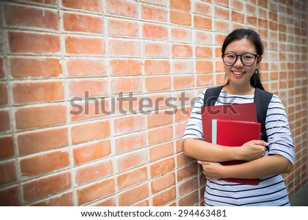Happy teen high school student - stock photo
