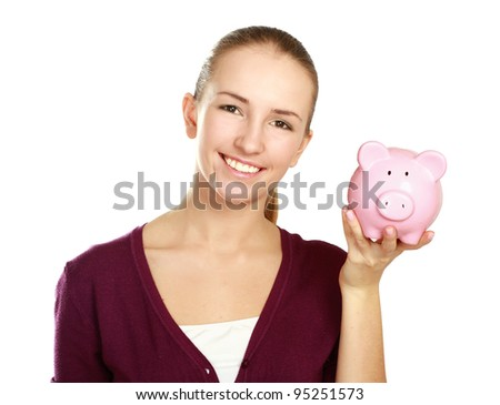 Happy teen holding a piggy bank and dollars - stock photo
