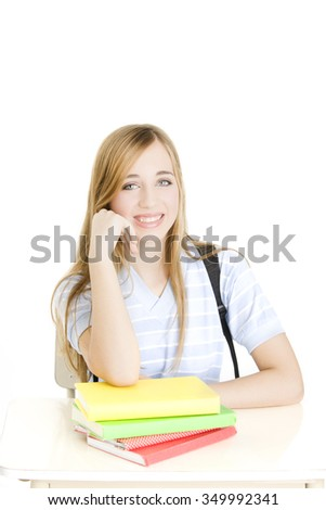 Happy teen student with books and backpack