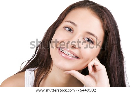 Happy teen with  braces - stock photo