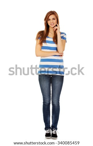 Happy teen woman with folded arms. - stock photo