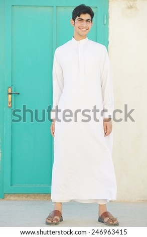 Happy teenage Arabic boy - stock photo