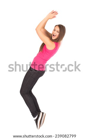 Happy Teenage Attractive Girl In Pink Shirt Perform Sport Pose On Tiptoe - stock photo