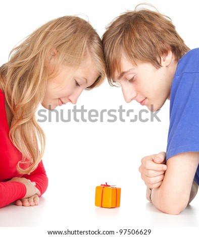 happy teenage couple with gift box, white background - stock photo