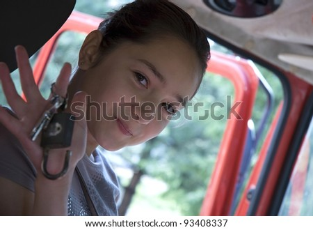 Happy teenage driver holding keys