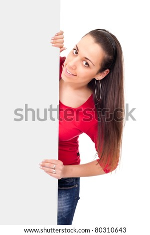 happy teenage girl behind empty billboard on white background