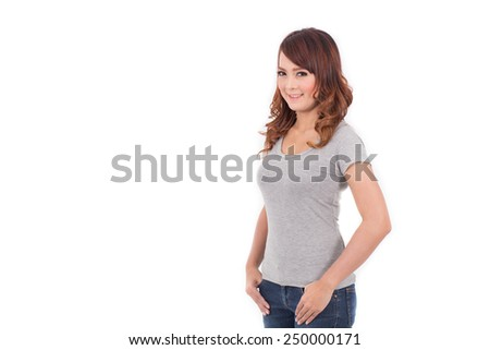 happy teenage girl in blank gray t-shirt on white background - stock photo