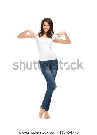 happy teenage girl in blank white t-shirt - stock photo