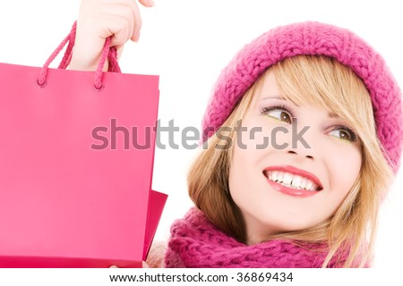 happy teenage girl in hat with pink shopping bags - stock photo
