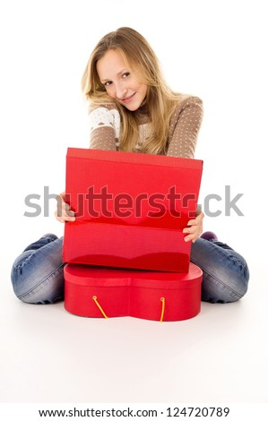 happy teenage girl sitting near the gift boxes - stock photo