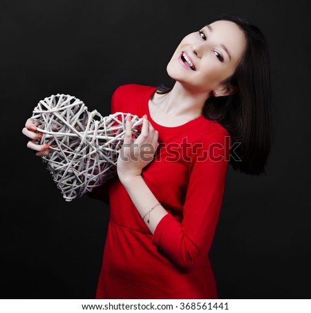 happy teenage girl with a heart in her hands, Valentine's day topic - stock photo