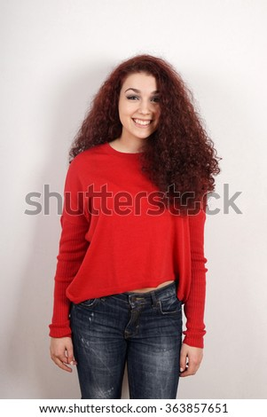 happy teenage girl with curly hair - stock photo