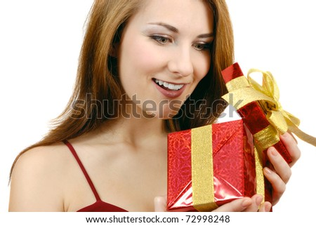 Happy teenage girl with gift box over white background - stock photo