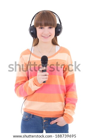 happy teenage girl with headphones and microphone isolated on white background - stock photo