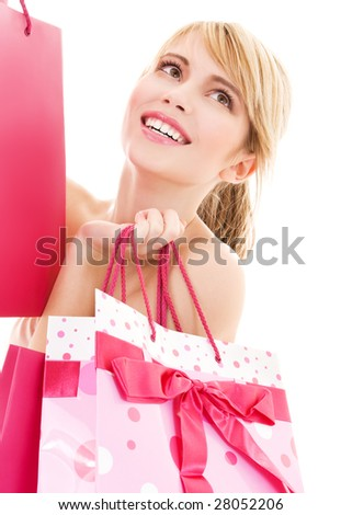 happy teenage girl with pink shopping bags - stock photo
