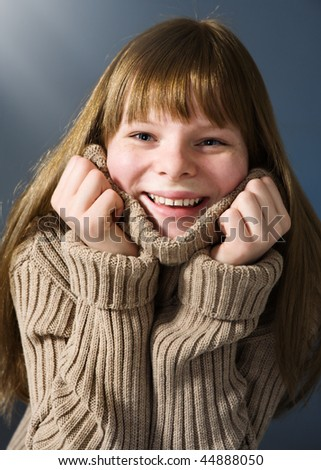 Happy teenage girl with sweater - stock photo