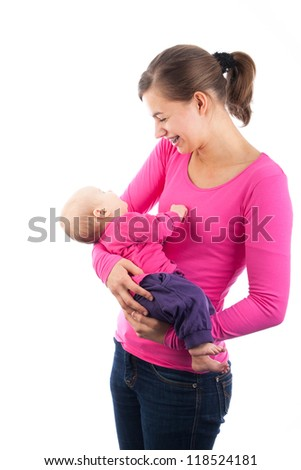 Happy teenage mother holding baby isolated on white - stock photo