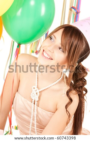 happy teenage party girl with balloons over white - stock photo