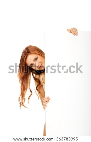 Happy teenage woman with blank board