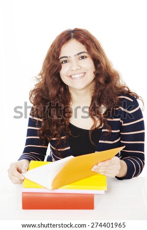 Happy teenage woman with book isolated on white