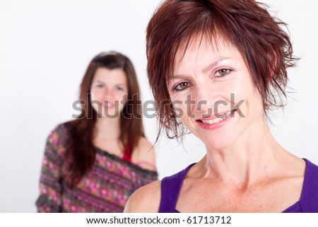 happy teenager girl and middle aged mother - stock photo