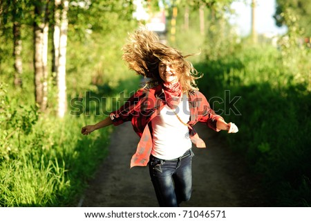 happy teenager girl in red shirt walking - stock photo