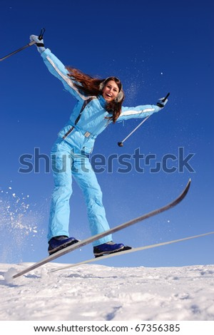 happy teenager girl jumping with skies - stock photo