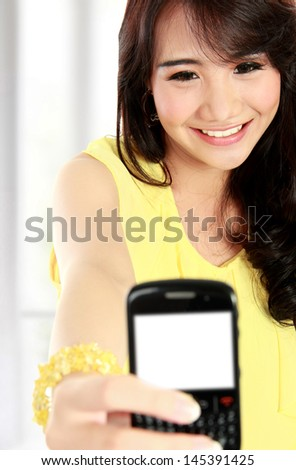 happy teenager girl take the picture her self with handphone - stock photo