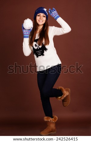 Happy teenager girl with snowball - stock photo