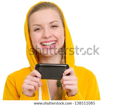 Happy teenager girl writing sms