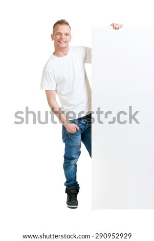Happy teenager holding a blank banner isolated on white