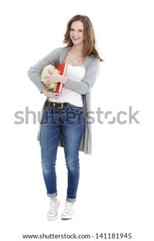 Happy teenager holding books against the white background