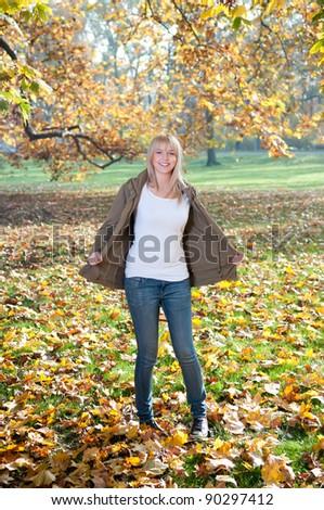 happy teenager in autumn park - stock photo