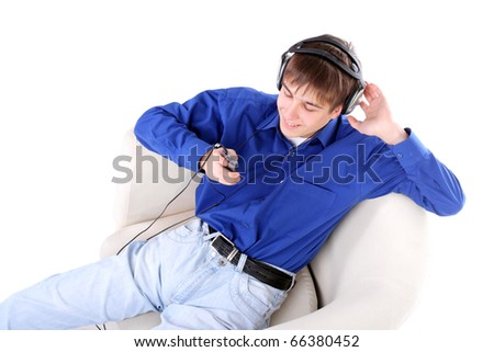happy teenager in headphones sitting in a chair with mobile phone - stock photo