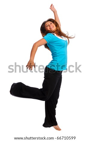 Happy teenager jumping in studio, isolated on white - stock photo