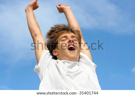 happy teenager jumping on sky background