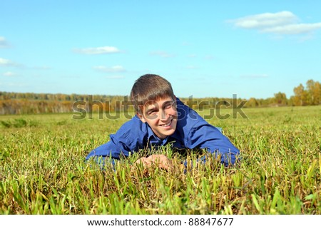 happy teenager lying in the field