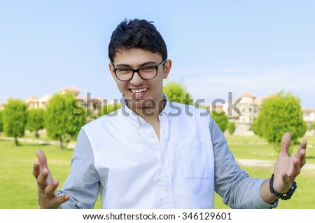 Happy Teenager outdoor with opened hand. - stock photo