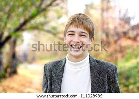 happy teenager portrait in the autumn park - stock photo